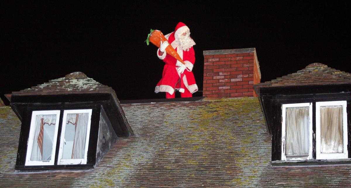 santa going down the chimney in wareham