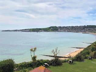holiday cottage for sale with a sea view